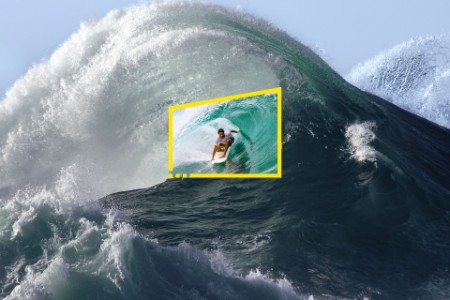Surfer in tube of giant wave